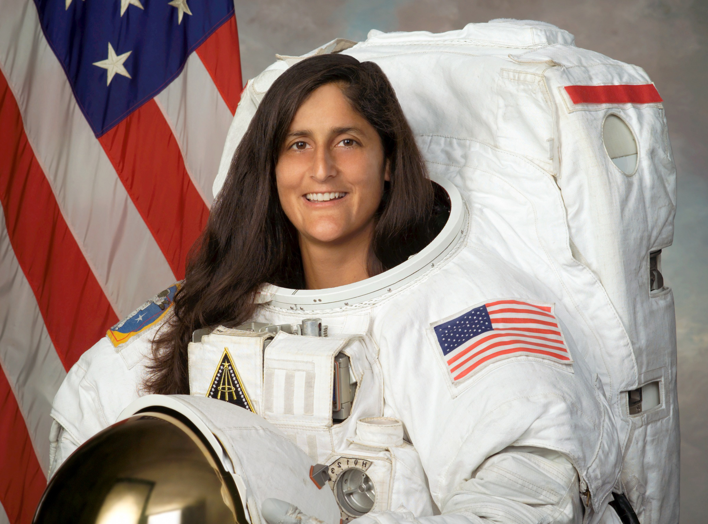 In this Sept. 22, 2004 photo provided by NASA, astronaut Sunita Williams poses for a photo. Williams is one of four veteran astronauts selected to fly the first commercial space missions, NASA announced, Thursday, July 9, 2015. (NASA via AP)